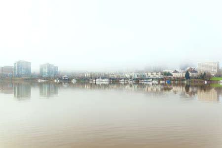 A foggy day in Portland Oregon city downtown waterfront along Willamette River