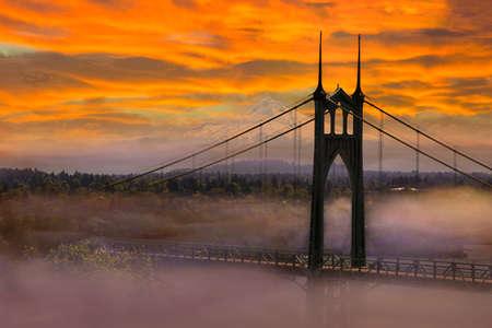 Mount Hood by St Johns Bridge in Portland Oregon on a foggy morning sunrise