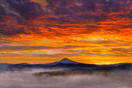 First Light on Mount Hood in Oregon City during foggy sunrise in fall season