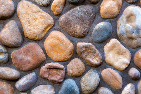 River stone rock wall grunge texture;background Stock Photo