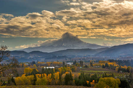 Rolling Clouds over Mount Hood in Hood River Oregon agriculture farmland in fall season Stock Photo