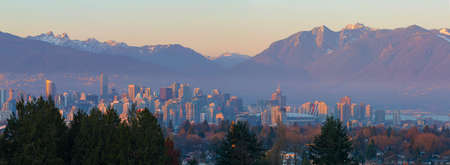 Vancouver British Columbia city skyline and mountain view during sunset panorama