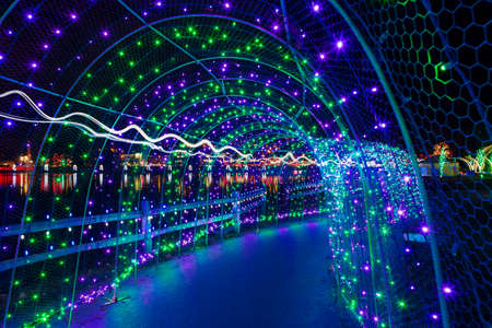 Christmas lights in tunnel along Lafarge Lake in Coquitlam British Columbia Canada at night