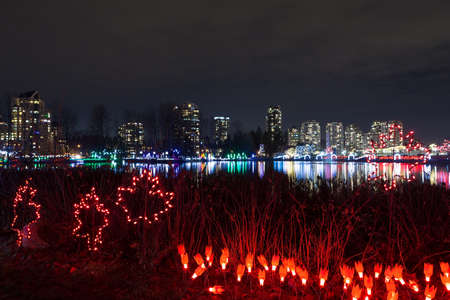 Christmas lights decoration along Lafarge Lake in city center of Coquitlam British Columbia Canada at night