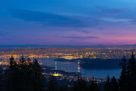 Vancouver British Columbia Canada cityscape with Lions Gate Bridge at Stanley park during Sunset