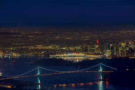 Vancouver British Columbia Canada cityscape with Lions Gate Bridge at Stanley park during evening blue hour