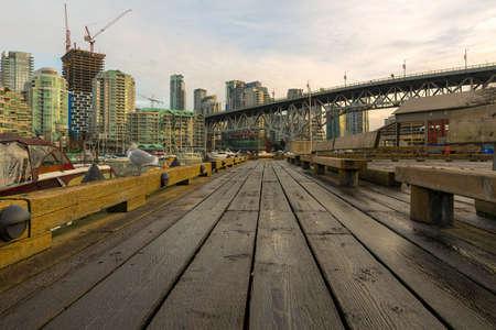 Condominiums aparment buildsing along Granville Island waterfront in British Columbia Canada