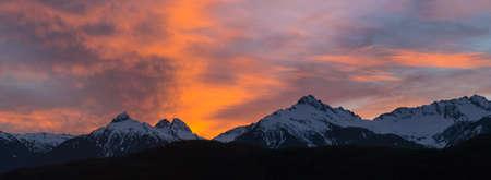 Sunset sky over Tantalus Range in British Columbia Canada during winter panorama Stock Photo