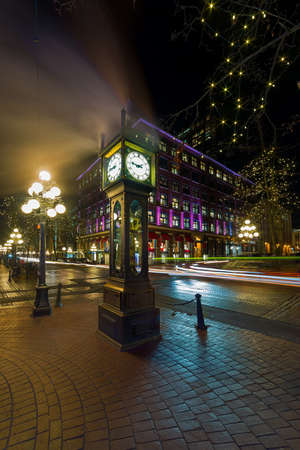 Steam Clock in Gastown in Vancouver British Columbia Canada with cars light trails at night