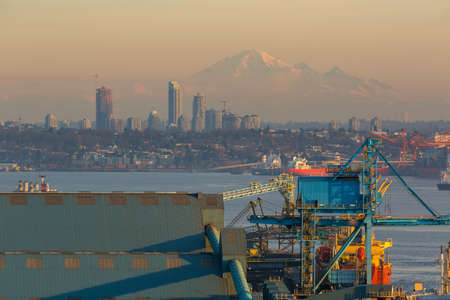View of Vancouver British Columbia with Mount Baker in Washington State during sunset