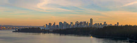 Vancouver British Columbia Canada  downtown city skyline by Stanley Park during sunset panorama