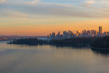 Vancouver British Columbia Canada  downtown city skyline by Stanley Park during sunset Stock Photo