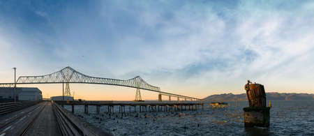 By the Astoria-Megler Bridge on Riverwalk by Columbia River at Oregon Coast Panorama