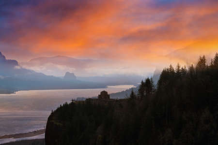 Vista House on Crown Point along Columbia River Gorge during sunrise Stock Photo