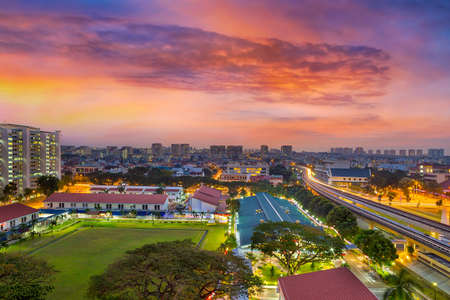 Sunrise over Eunos residential neighborhood by MRT commuter train station in Singapore Stock Photo