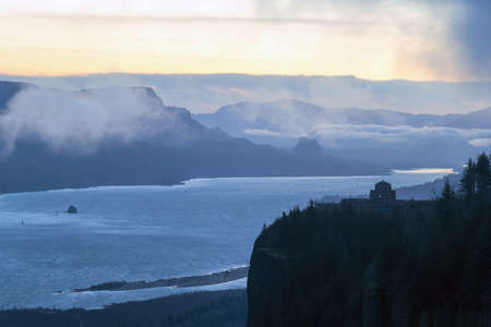 Early morning foggy dawn view of Crown Point and Beacon Rock along Columbia River Gorge between Oregon and Washington State