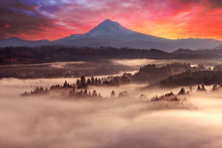 Foggy sunrise over Sandy River Valley and Mount Hood in Oregon