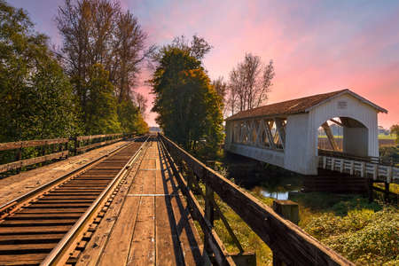 Gilkey Covered Bridge over Thomas Creek in Scio Oregon during sunset