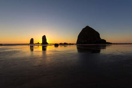 Haystcak Rock and the Needles at Cannon Beach Oregon Coast low tide during sunset Stok Fotoğraf