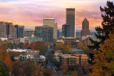 Portland Oregon downtown cityscape with Mount Hood during colorful sunrise in Fall season