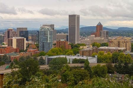 Portland Oregon downtown cityscape by freeway nestled among trees