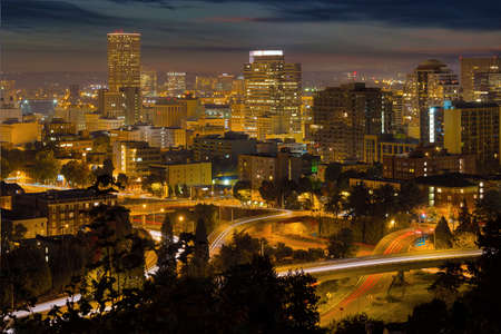 Portland Oregon downtown cityscape and freeway with light trails at night Stock Photo