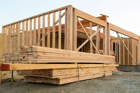 Wood Lumber Studs and Beams by House Construction Framing Stock Photo