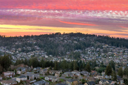 Colorful sunset sky over Happy Valley Oregon residential suburban neighborhood Stock Photo