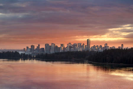 Colorful dramatic sunset color sky over Stanley Park and downtown city Vancouver BC British Columbia Canada