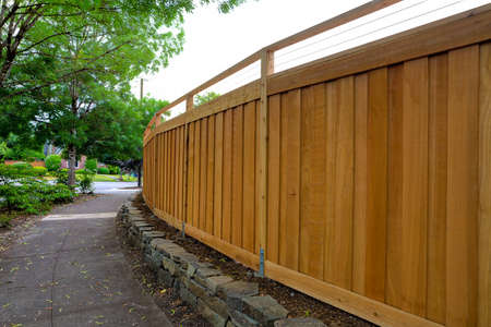 New Cedar Wood Fence around home backyard property landscaping