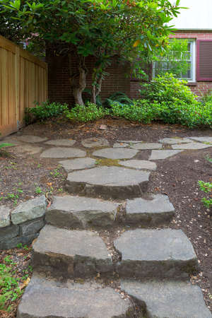 Steeping Stone Steps and Path to house fenced backyard garden Stock Photo