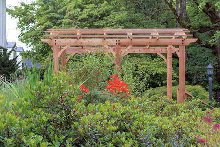Wood Arbor in home garden backyard lush landscaping