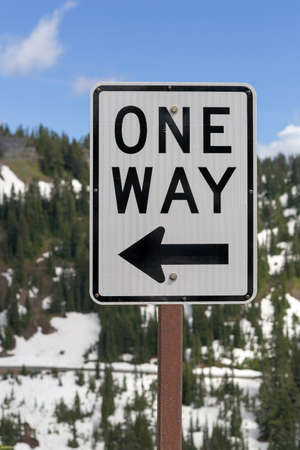 One Way road sign along highway in Mt Rainier National Park Washington State Stock Photo