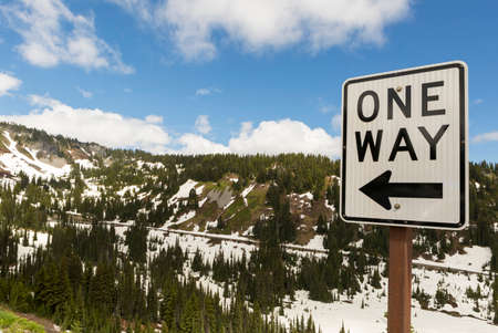 One Way drive along highway in scenic Mount Rainier National Park Washington State Stock Photo