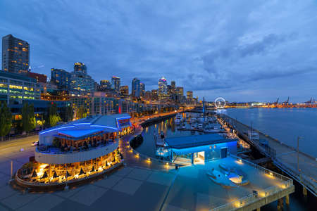 Seattle Washington downtown skyline from the pier along the waterfront during evening blue hour