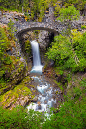 Christine Falls under stone bridge over Van Trump Creek along scenic drive in Mount Rainier National Park Washington State