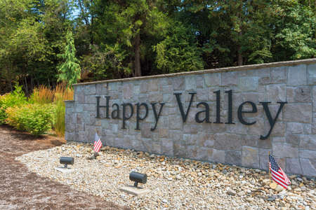 City of Happy Valley Oregon stone wall in the park with landscaping closeup