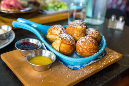 Danish pancakes with powdered sugar lemon curd and lingonberry jam dips breakfast dish Stock Photo