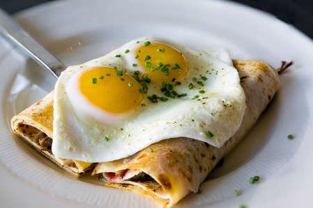 Lefse Norwegian Potato Crepes with baked sunnyside eggs chives breakfast dish
