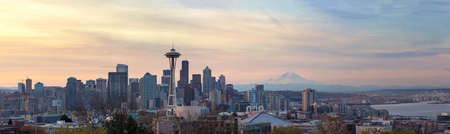 Seattle Washington downtown ckty skyline with Mount Rainier on a beautiful sunrise morning panorama