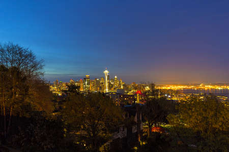 Seattle Washington city skyline by Puget Sound Harbor and port during early dawn blue hour Stock Photo