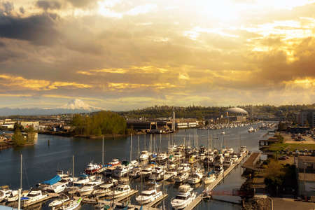 Boat Dock along Thea Foss Waterway in Tacoma Washington with Mount Rainier during golden sunset Stock Photo