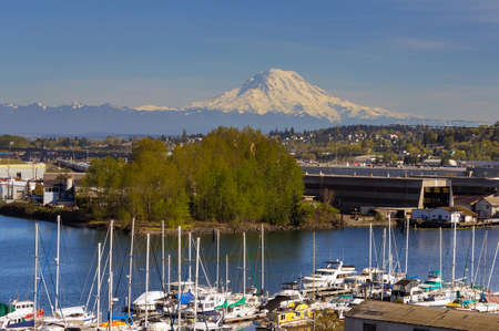 Mount Rainier over Foss Thea Waterway in Tacoma Washington on a blue sky sunny day