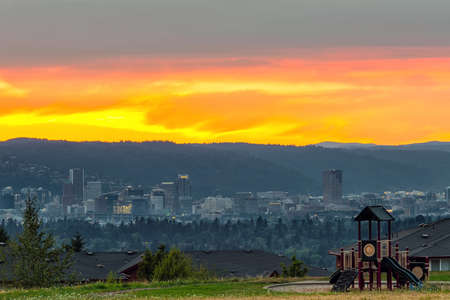 Portland Oregon downtown city skyline by childrens playground in Altamont Park on Mt Scott during sunset 写真素材 - 106270709