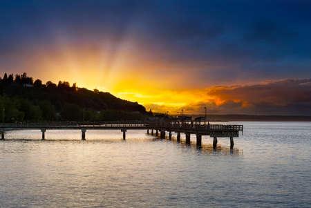 Sunset along Ruston Way by fishing pier on Commencement Bayin Tacoma Washington