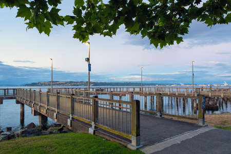 Fishing pier along Ruston Way along the waterfront in Tacoma Washington during blue hour evening
