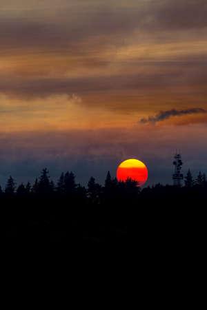 Smokey hazy sunset sky over Mount Scott in Oregon