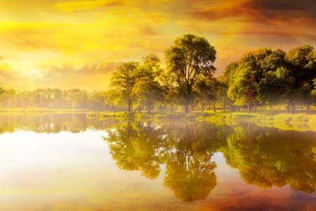 Foggy golden sunrise by the fishing lake at Trojan Park in Rainier Oregon Stock Photo