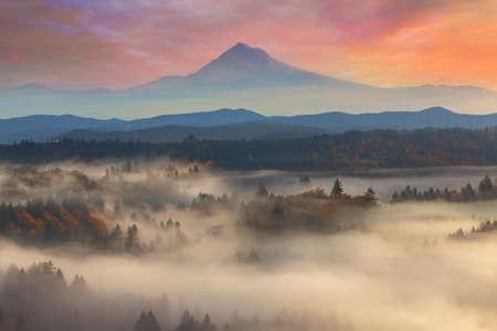 Mount Hood over foggy Sandy River Valley sunrise during fall season