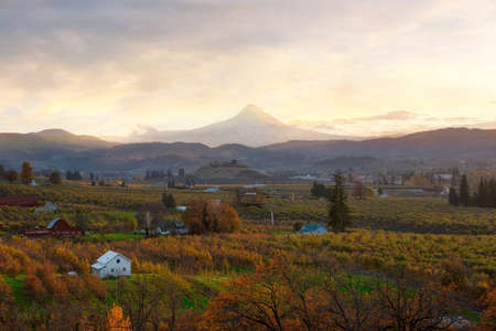 Hood River and Mount Hood during sunset in fall season Stock Photo